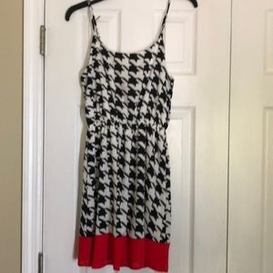 Black and white dress with red bow and trim